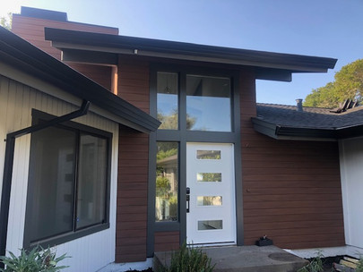 Contemporary front entry with dark accents