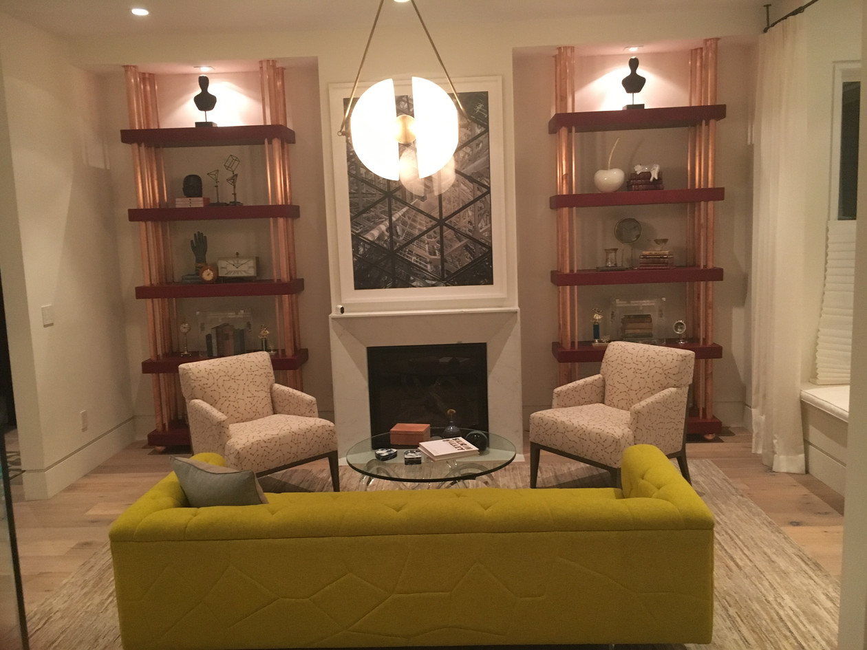 Small living space with built-in shelving and fireplace