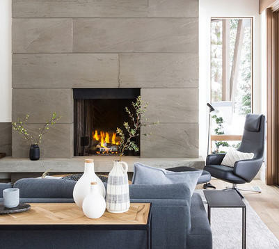 Small living space with stone tile mantel