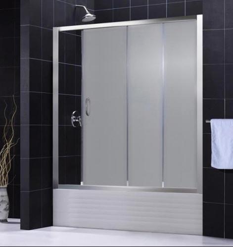 Framed glass shower against stone tile detail