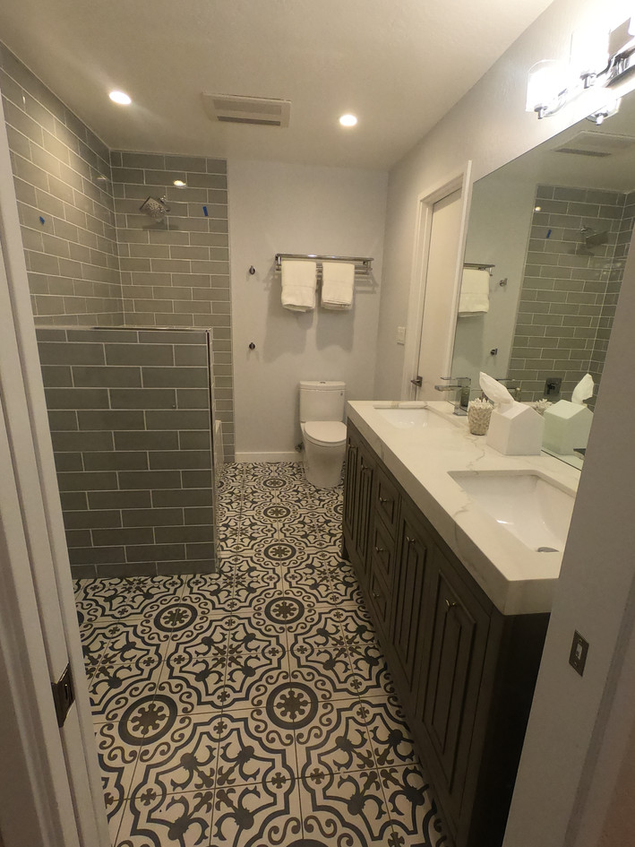 Long bathroom space with natural stone detail and custom tiling