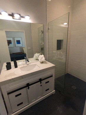 Lipless walk-in shower and sink area