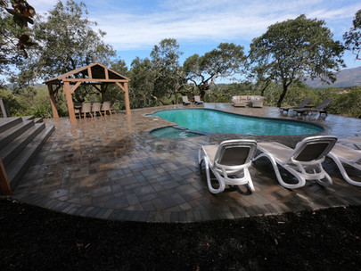 Outdoor pool with jacuzzi and gazebo