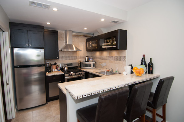 Small open kitchen space with counter seating
