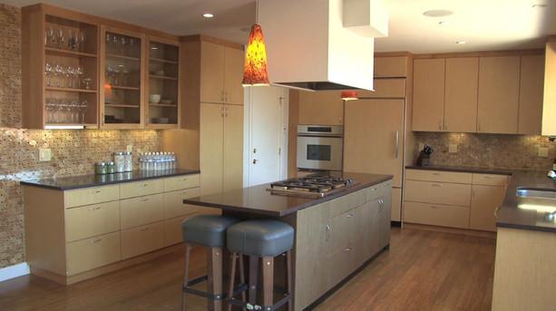 Custom multipurpose kitchen with built in island and hidden fridge