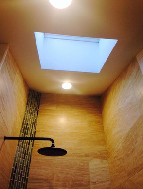 High-ceiling shower under a skylight