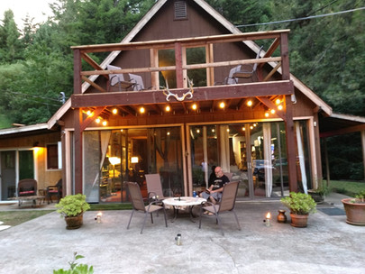 A-frame home with deck overhang and patio space