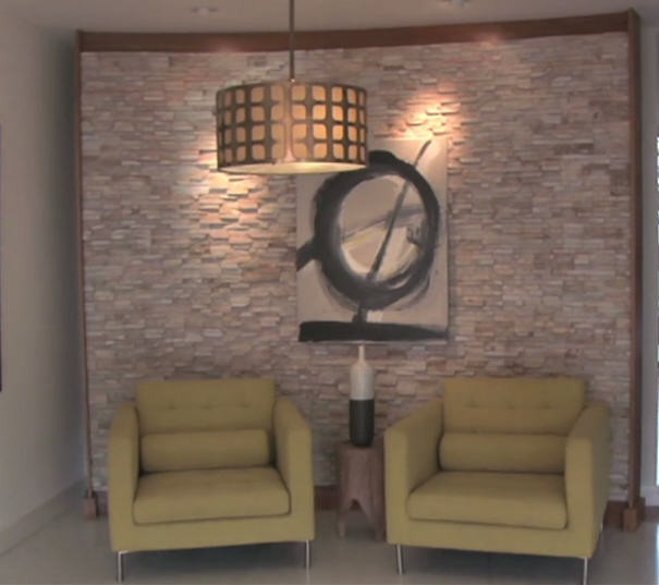 Small seating area with natural stone wall