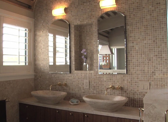 Dual vanity with natural stone and tile accents