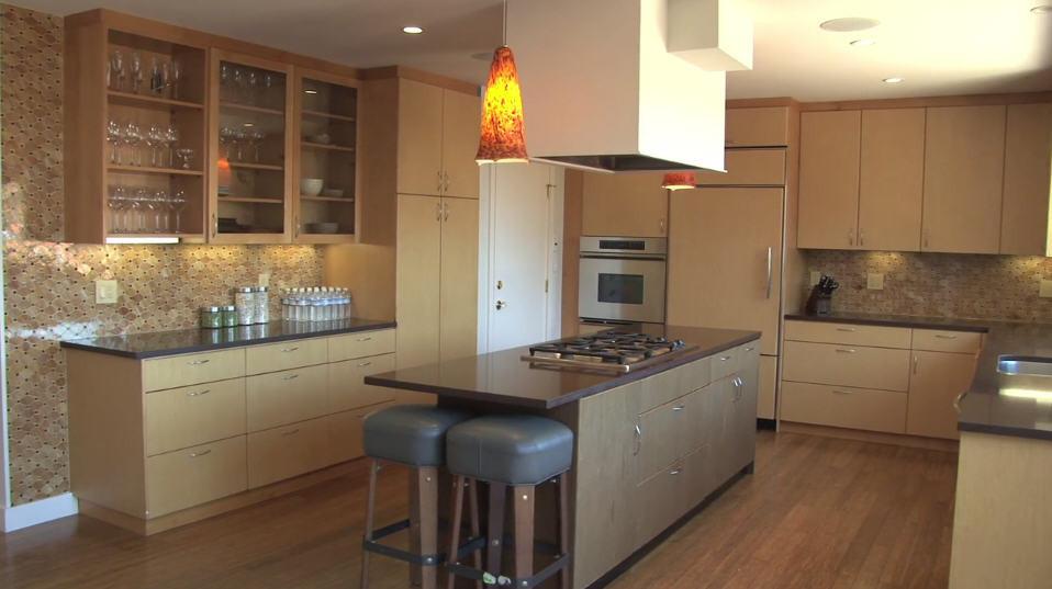 Multipurpose kitchen with built-in island and hidden fridge