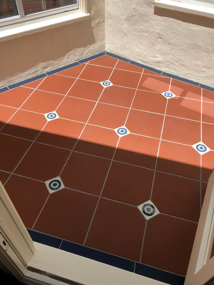 Outdoor terra cotta tile flooring for patio space