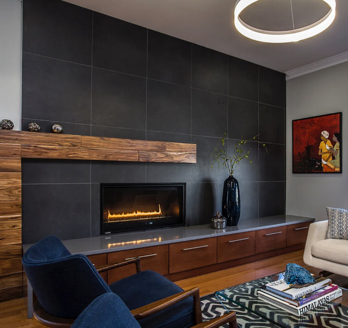 Stone tile mantel, abstract wood shelving and built-in storage