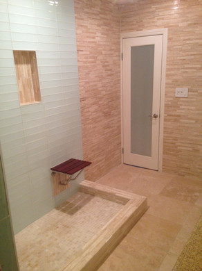 Bathroom with open shower and bench