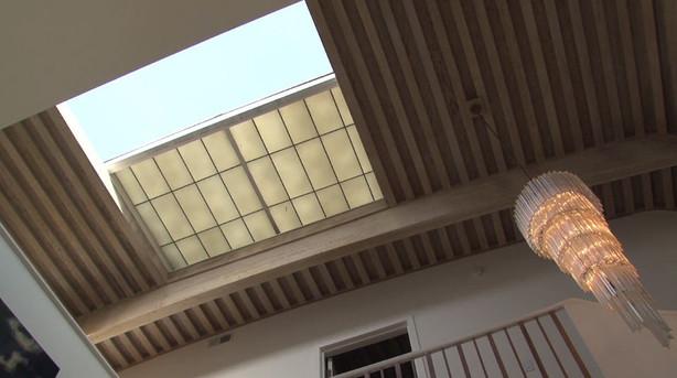 Custom opening skylight