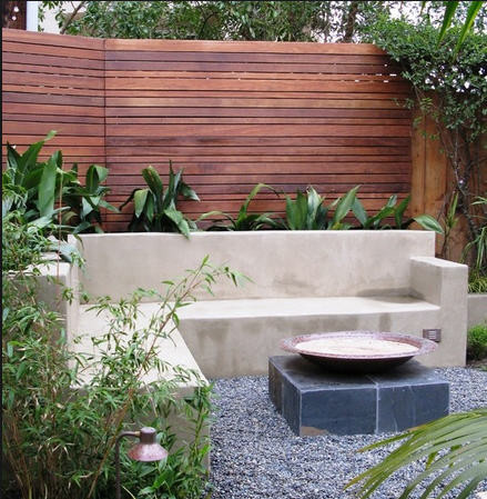 Concrete planter seating with fire pit