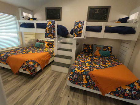 Child's bedroom with custom multi-function loft bunk beds