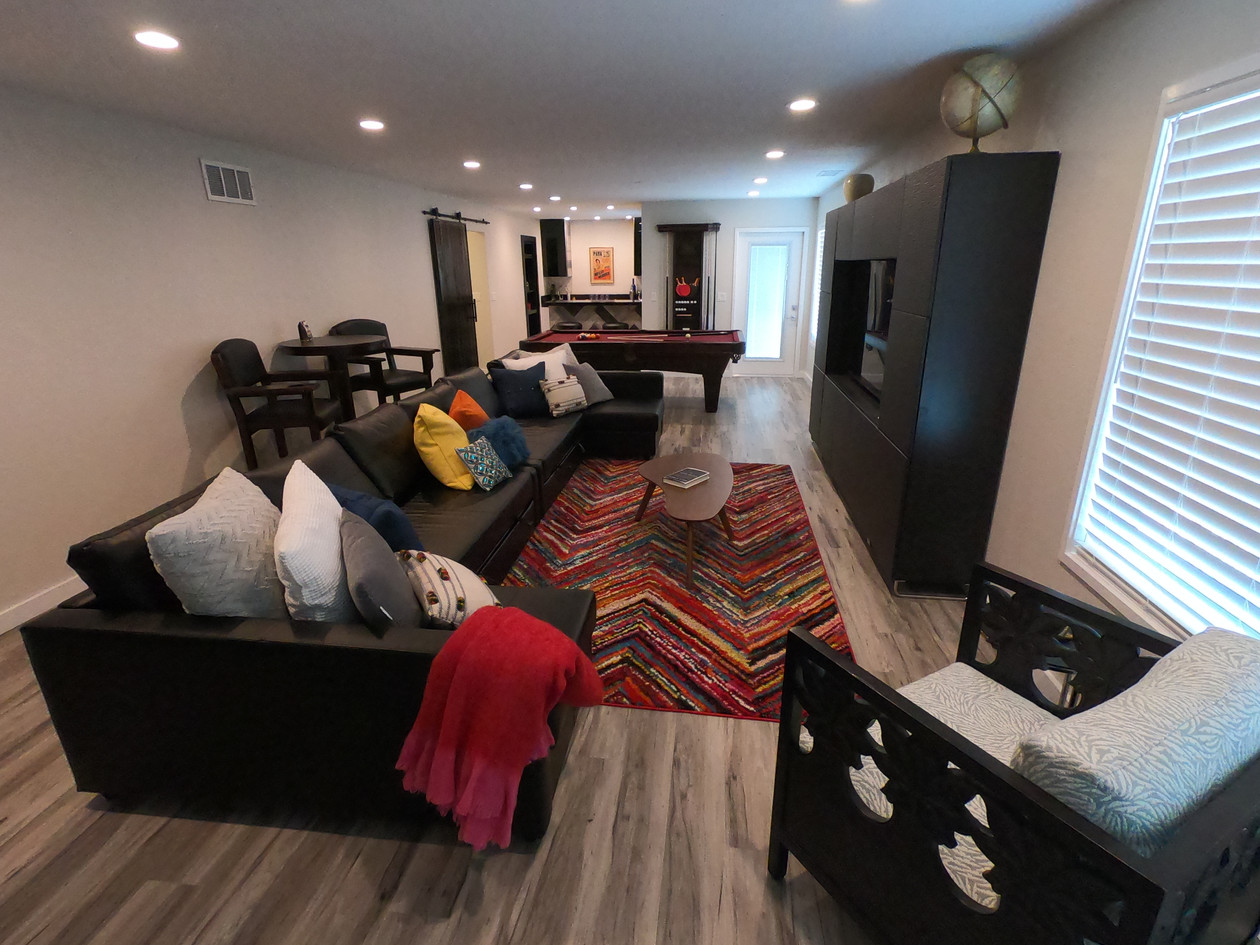 Oblong living space with a built-in entertainment system