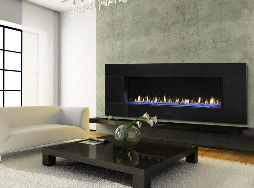 Light-filled living space with concrete wall and electric fireplace