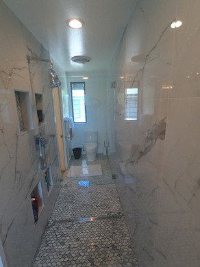 Long bathroom with open shower