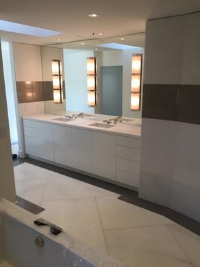 Bath with dual vanity and hidden storage