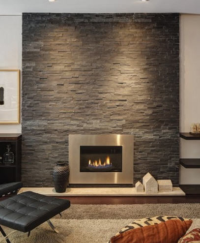 Carpeted lounge area with natural stone wall mantel