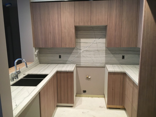 Smaller kitchen space with wood and stone accents