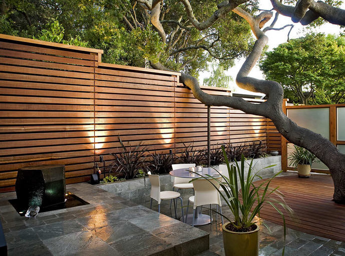 Shaded patio and elevated outdoor cooking space