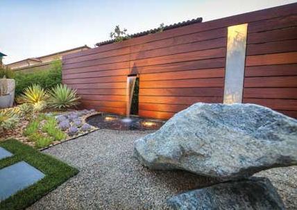Rock garden and falling water stone fountain