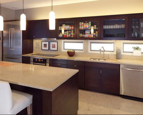 Large kitchen space with counter seating and glass cabinet doors