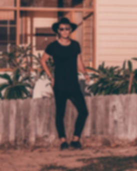 beach man pose black hat watch wood