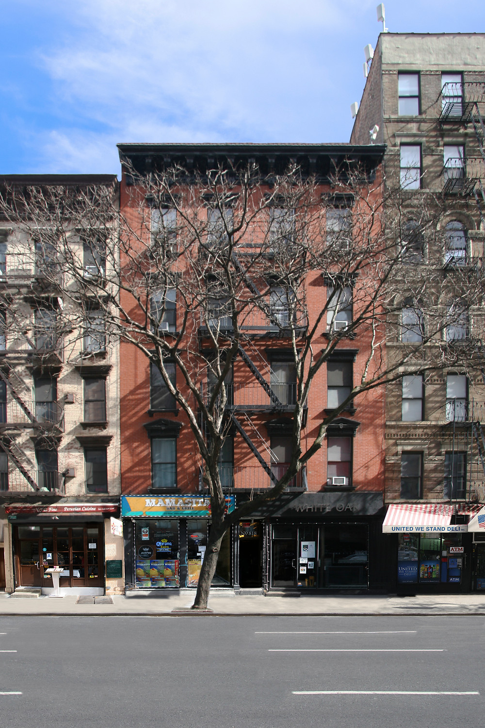 Located at 818 10th Ave. in Manhattan, the 12,330-square-foot building features 12 residential units and two restaurants.