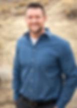 Blue shirt headshot.jpg