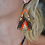 Thumbnail: Boucles d'oreilles triangle Massaï brun/orange