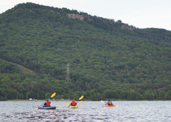 Three kayakers and the mountain.JPG
