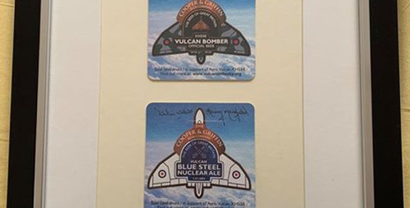 Vulcan signed and mounted beer mats