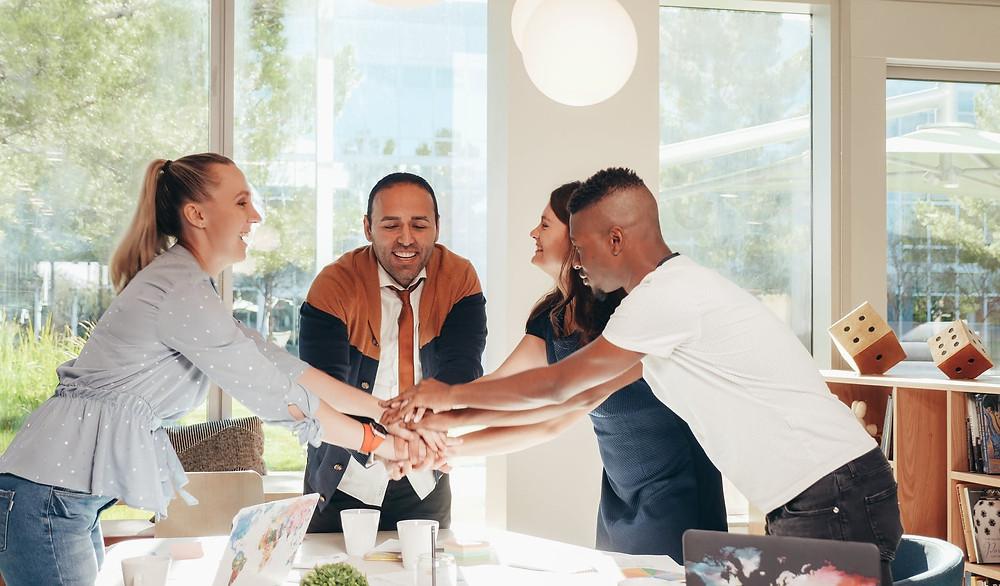 Diverse workplace employees handshake in meeting