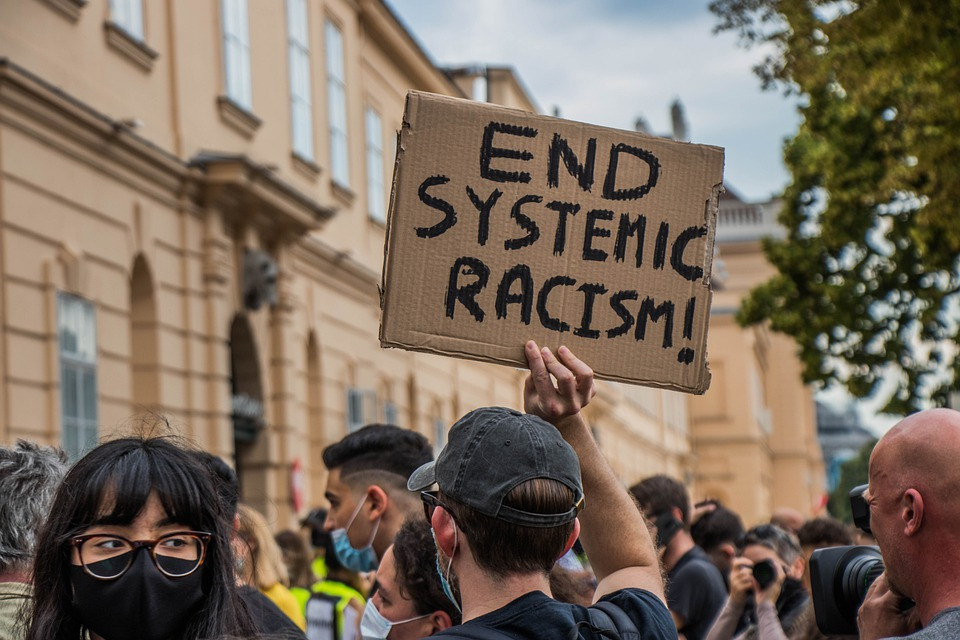 CRT was created to counter systematic racism. Opponents see it as divisive.