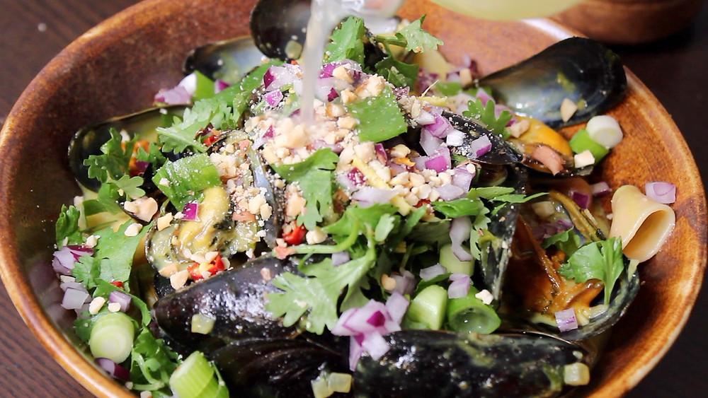 Garnishing mussel curry