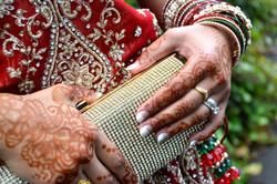 Bride holding her wedding diamante studded clutch