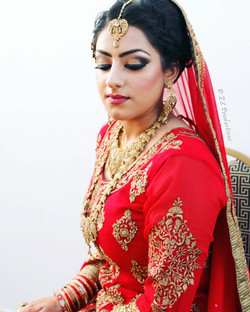 Bride in traditional red wedding dress just before rukhsati ceremony