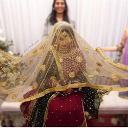 Sheffield bride during her rukhsati ceremony with scarf on head
