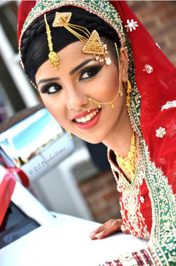 Outdoor photo of bride posing in traditional wedding dress and jewellery