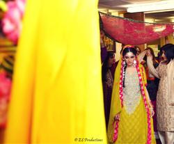Mehndi bride showing her mehndi dress