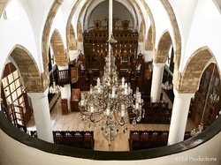 Cypriot wedding at a Cyprus church from a birds eye view and showing chandelier