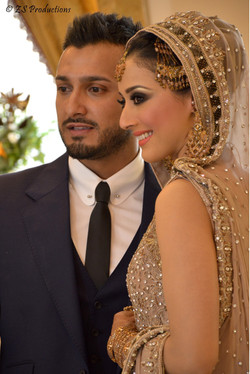 Shama malik and her husband posing together and smiling as a couple on their wedding day