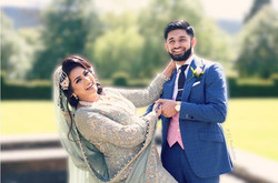 Bride and groom posing at Guisborough hall hotel