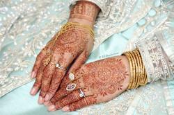 Bury bride showing her bridal hand jewellery and mehndi henna tattoos