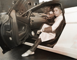 Groom wearing sharwani and stepping out of his super car in sepia tint