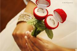 Wedding rings displayed in ring holders