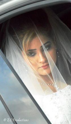 Veiled bride before wedding registry